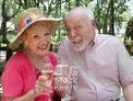 Elderly couple enjoying refreshments