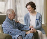 Elderly man with caregiver
